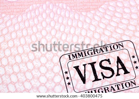 Immigration visa stamp passport page close up copy space