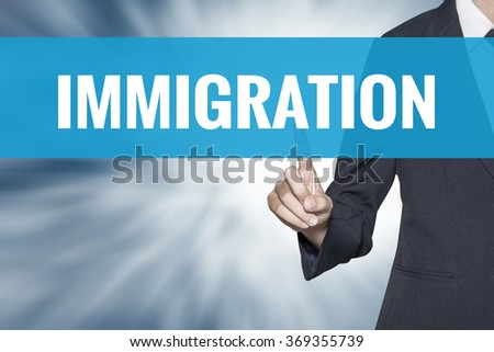 Immigration word on virtual screen touch by business woman cyan sky tab - stock photo