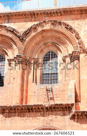 Immovable Ladder on the Church of the Holy Sepulchre in Old City of Jerusalem - stock photo