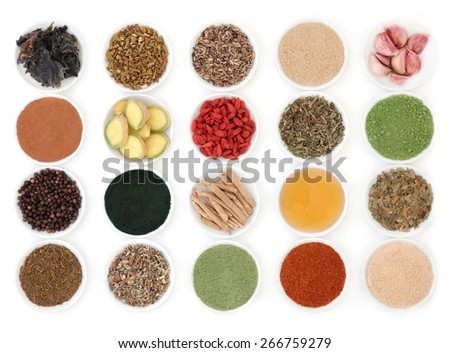 Immune boosting super food selection in porcelain dishes over white background.
