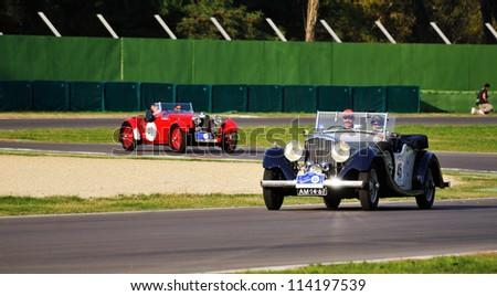 IMOLA (BO) ITALY - SEPTEMBER 21: Blue Bentley Darby (1935) and red Aston Martin Le Mans (1933), take part to the GP Nuvolari 2012, on September 21, 2012 in Imola Autodrome (BO) - stock photo