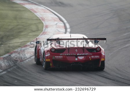 Imola, Italy - October 11, 2014: A Ferrari 458 Italia Gt3 of Baldini 27 Network Srl team, driven By Giammaria Raffaele (Ita) and Casa Lorenzo (Ita),  the C.I. Gran Turismo car racing