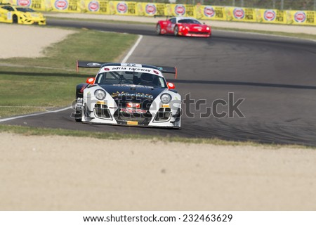 Imola, Italy - October 11, 2014: A Porsche 997 Gt3 of Krypton Motorsport team, driven By Pezzucchi Stefano (Ita) and Bianco Riccardo (Ita),  the C.I. Gran Turismo car racing - stock photo