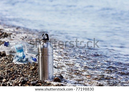 Impact of disposables, like plastic water bottles, on clean water and the environment. - stock photo