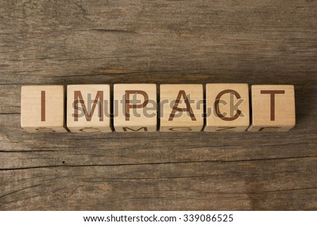 IMPACT text on a wooden background - stock photo