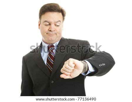 Impatient businessman checks his watch.  Isolated on white. - stock photo