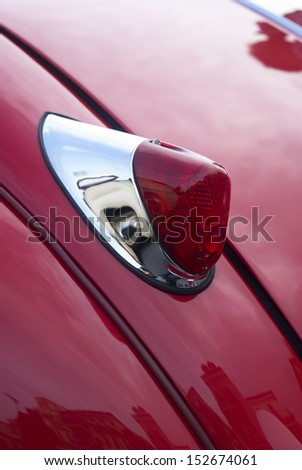 IMPERIA, ITALY - MAY 13: Close up detail of a sports old car Jaguar XK120 parked in a street in Imperia, Italy on May 13, 2011. - stock photo