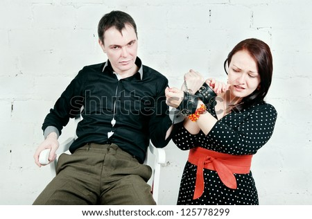 Imperious man and woman in handcuffs - stock photo