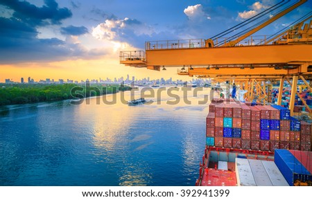 Import Cargo River Side And Containers On Top Of Shipyard At Sunset View - stock photo