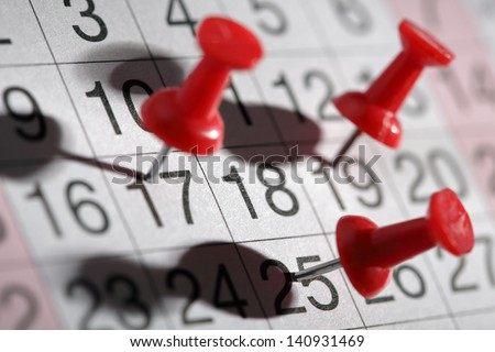 Important date or meeting appointment reminder concept thumbtack on calendar - stock photo