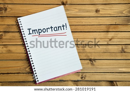 Important word on notebook page - stock photo