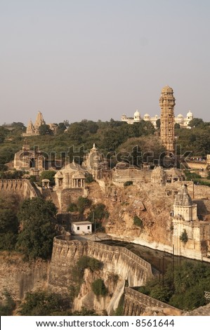 Imposing fortress standing on rocky hill above surrounding plains. Chittaugarh, Rajasthan India. - stock photo