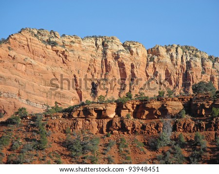Imposing layers of red rock cliffs in scenic, beautiful Sedona, Arizona, where mystery is palpable! - stock photo