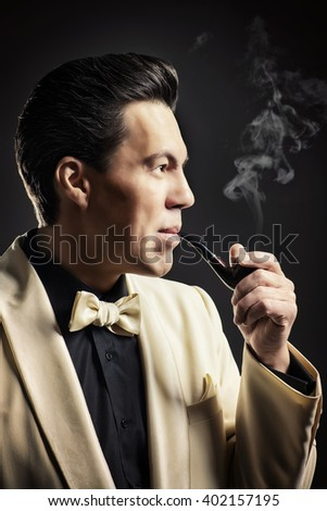 Imposing mature man with a haircut in the style of the 60s. - stock photo
