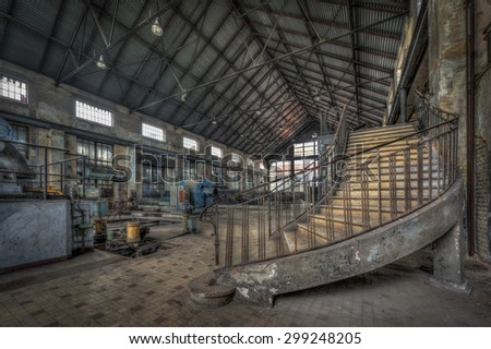 Imposing staircase inside the hall of an abandoned power plant, HDR processing