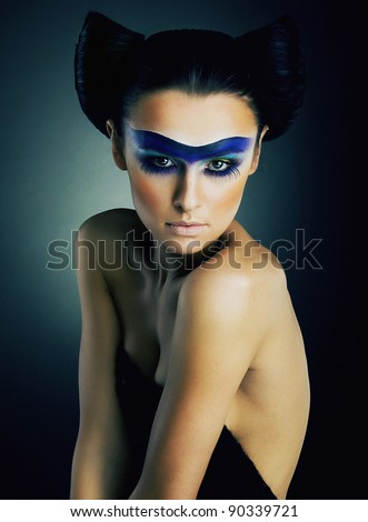 Imposing young girl with dramatic make up on her face studio shot - series of photos - stock photo