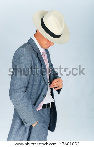 Imposing young man dressed in a suit and hat