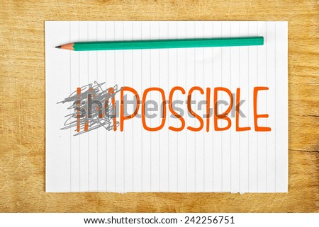 Impossible is Possible Concept with Pencil and Piece of Paper. - stock photo