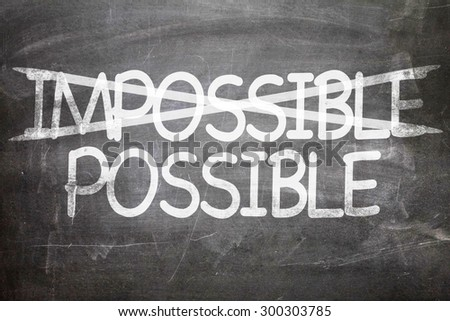Impossible Possible written on a chalkboard