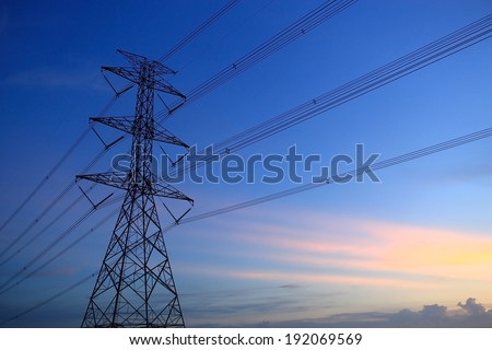 Impression network at transformer station in sunrise, high voltage up to full color sky take with sunset tone, horizontal frame  - stock photo