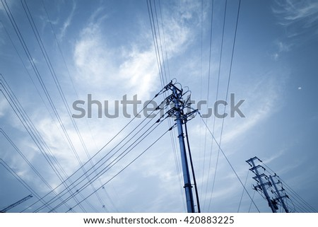 Impression network at transformer station in sunrise, high voltage up to yellow sky take with yellow tone, horizontal frame - stock photo