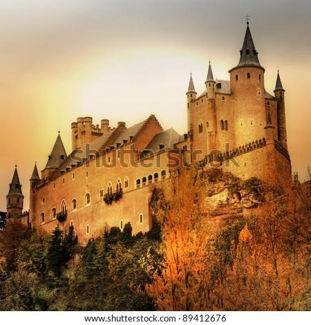 impressive Alcazar castle on sunset - Segova, Spain - stock photo