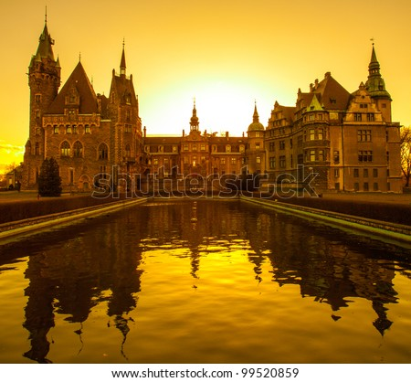 Impressive castle at sunset - stock photo