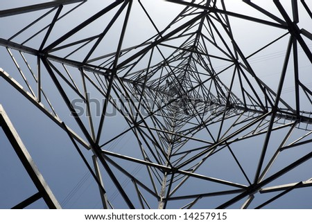 Impressive electric pylons transporting electricity through high tension cables. - stock photo