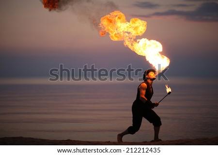 Impressive fire breath of a showman - stock photo