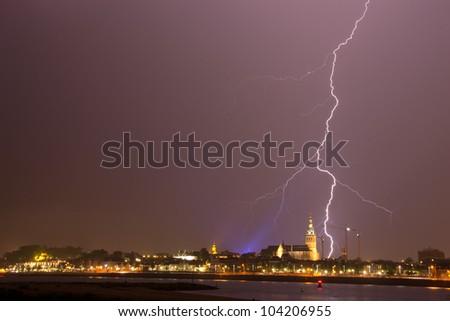Impressive lightning strikes the city of Nijmegen in the Netherlands. - stock photo