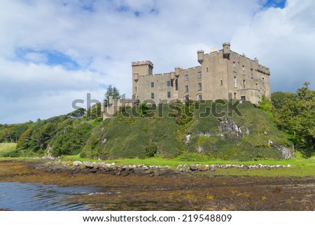 Impressive medieval Dunvegan Castle of the Clan MacLeod in Dunvegan, Scotland - stock photo