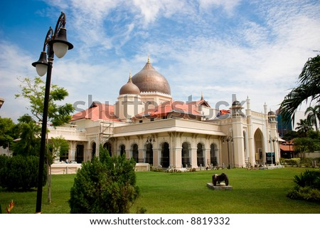 impressive mosque architecture with front garden, blue sky white clouds - stock photo