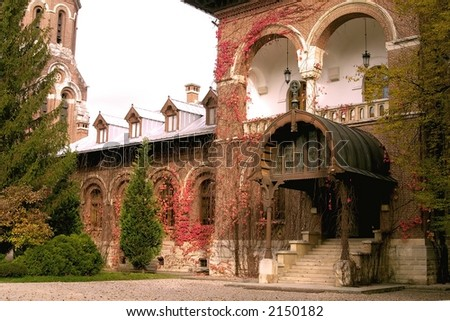 Impressive red brick walls old house in Curtea de Arges Monastery park - Romania. An imppresive relgious monument finished in 7 january 1517 by Neagoe Basarab