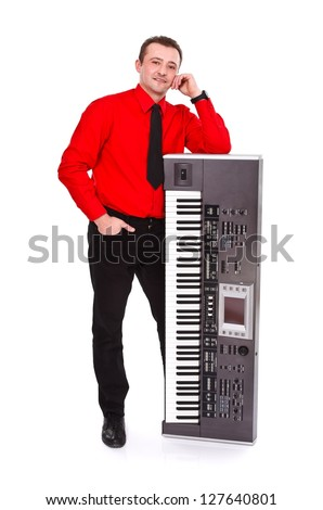 Impressive young man posing with synthesizer - isolated - stock photo