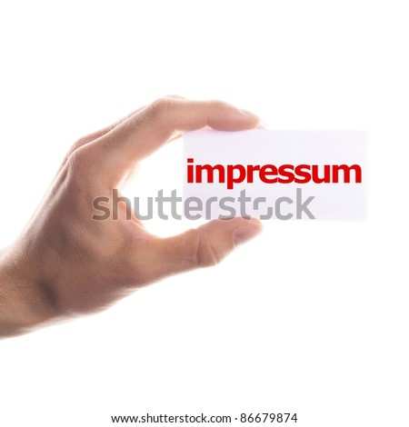 impressum concept with hand word and paper