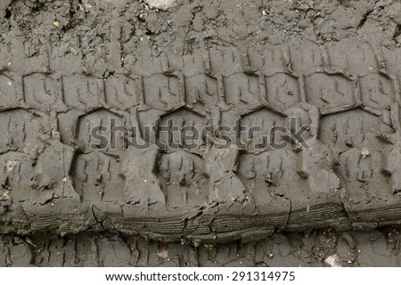 Imprint automobile tires on the dirty road
