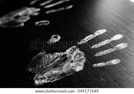Imprint of human hands,black background - stock photo