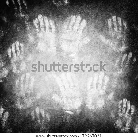 Imprint of human hands, black horror background, conceptual image of war and poverty, need help and protection concept - stock photo