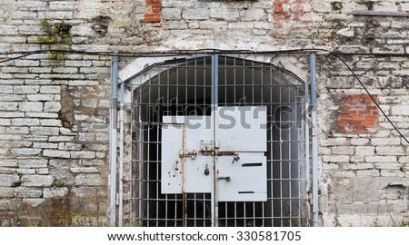 imprisonment, building concept - old prison gate - stock photo