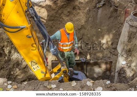 Improper construction of trenches has historically resulted in many construction-related injuries and fatalities due to trench collapses. Such incidents occurred during trench construction. - stock photo