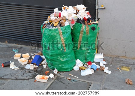 Improperly disposed bags of litter waste - stock photo