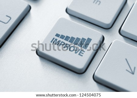 Improve button on the keyboard. Motivational concept. Toned Image. - stock photo