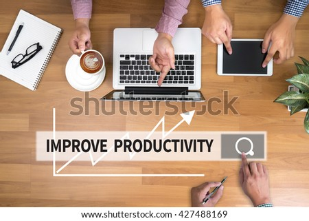 IMPROVE PRODUCTIVITY man touch bar search and Two Businessman working at office desk and using a digital touch screen tablet and use computer, top view - stock photo