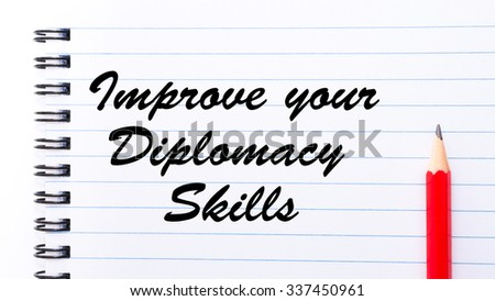 Improve Your Diplomacy Skills written on notebook page, red pencil on the right. Motivational Concept image - stock photo