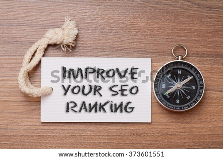 Improve your SEO ranking - blogging tips handwriting on label with compass - stock photo