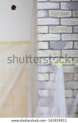 Improvement renovation at home decorate wall clinker brick tile glue finishing - stock photo