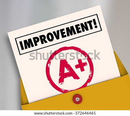 Improvement word on a report card with A plus grade to illustrate good results from studying or tutoring for school education - stock photo