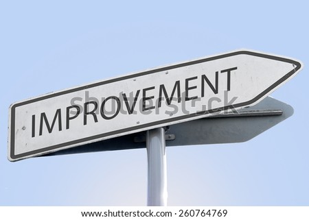 IMPROVEMENT word on road sign - stock photo