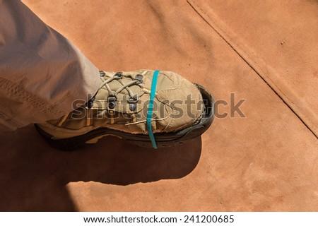 improvised repair for a broken trekking boot  - stock photo