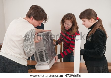 In a family event: are going to connect the new computer. - stock photo